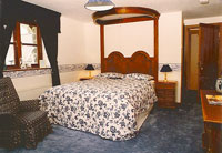 Tyddyn Mawr Guesthouse's luxurious blue bedroom upstairs with balcony